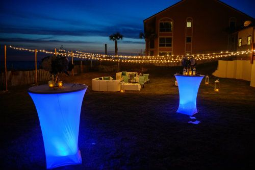 Cocktail Tables with blue uplighter at outdoor lounge area